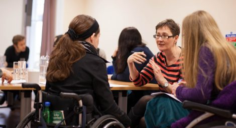 Disabled women in discussion.