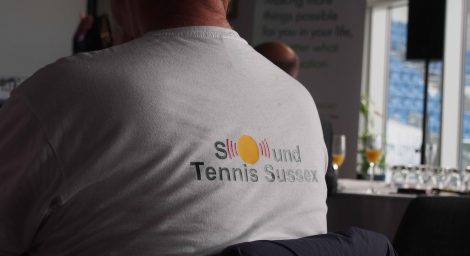 Member at launch event wearing sound tennis t-shirt