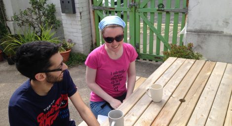 Two young people outside at a table