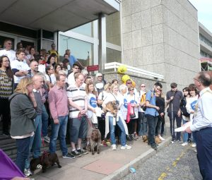 People gathered on steps before sponsored walk