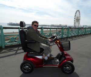 A person delivering a scooter in Brighton